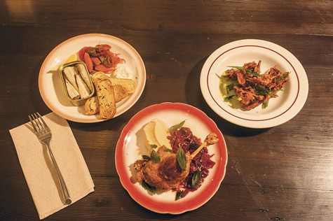 Try the Spanish tinned sardines, duck leg confit, and fritters at The Lede.