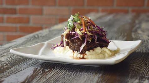 The tender short ribs at Saucy sit atop a bed of puréed cauliflower.