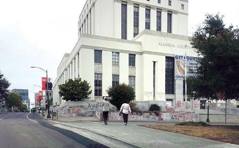 DAMAGED: The Alameda County courthouse near Lake Merritt in Oakland was vandalized on Saturday night following a protest in solidarity with demonstrators in Portland.