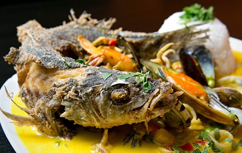 The pescado a lo macho comes with a whole fried fish, not a fillet.