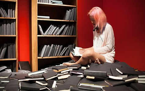Minji Sohn counted books' pages in her performance Again, and Again, and Again.
