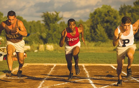 Stephan James (center) stars as Jesse Owens in Race.