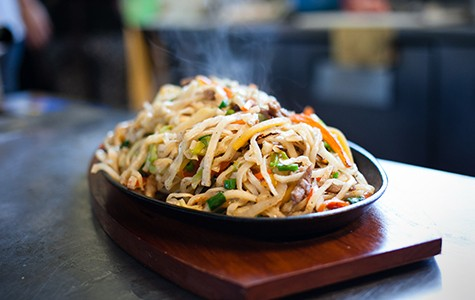 To make tsu-van, the handmade noodles are first steamed and then pan-fried.