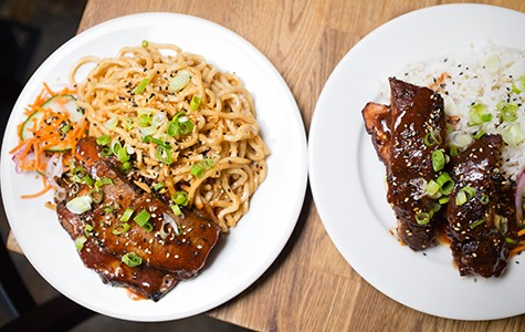 Brisket with a side of garlic noodles (left); baby back ribs with a side of coconut rice. Bert Johnson