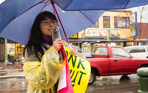 Activist Yvette Falarca protests for President Barack Obama to pardon those who successfully applied for DACA last month in the Fruitvale neighborhood.