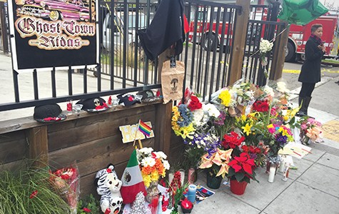 Flowers, candles, and memoriams placed near the site of the Ghost Ship warehouse in December. Nearly two months later, the Gray Area fund has yet to distribute any of the money it raised for victims and family.