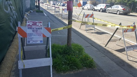 Dettaglio Construction blocked much of Hollis Street by displaying permits issued by San Francisco.