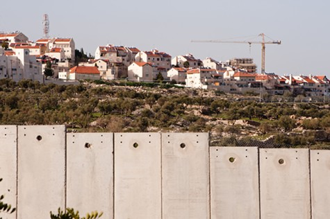 Construction cranes work to expand the Israeli settlement of Gilo.