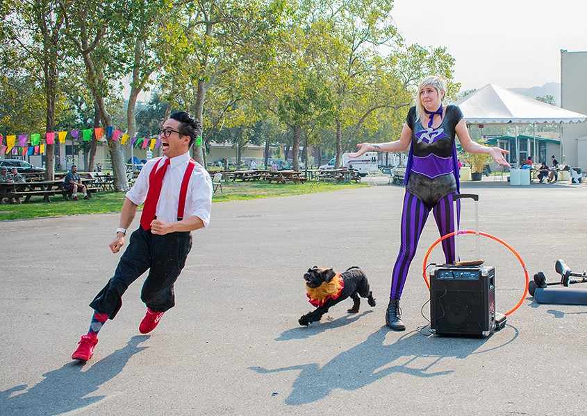 Calvin Kai Ku, Lily the dog, and Robin Lara performed for victims of the North Bay fires. - PHOTO BY JORDAN RANFT