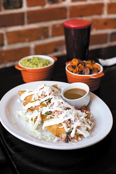 The deep-fried tacos are filled with smooth, creamy potatoes. - PHOTO BY MELATI CITRAWIREJA