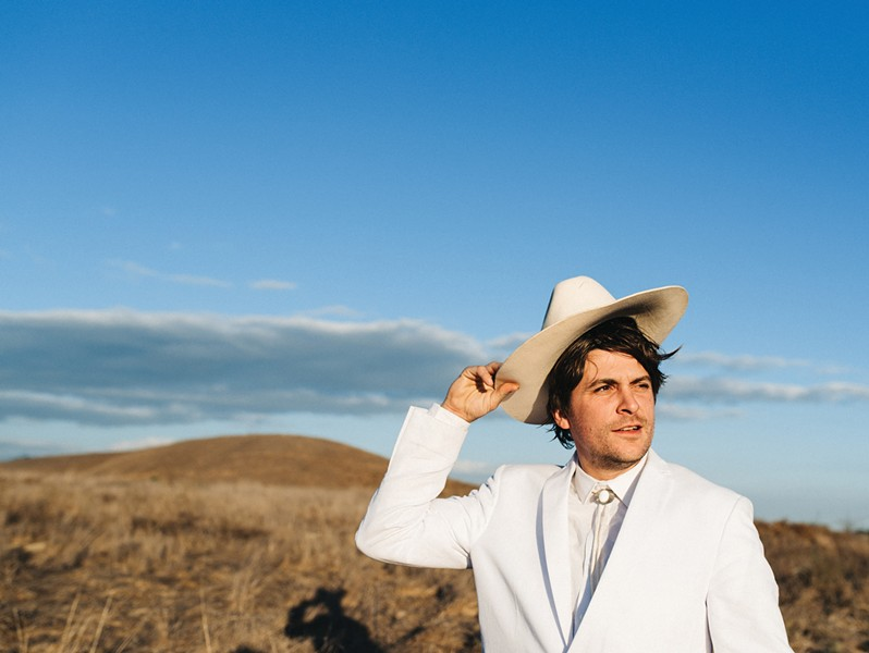 Dick Stusso is Nic Russo's outlet for his cynicism, a failure-prone fantasist in a cowboy hat. - PHOTO BY CARA ROBBINS