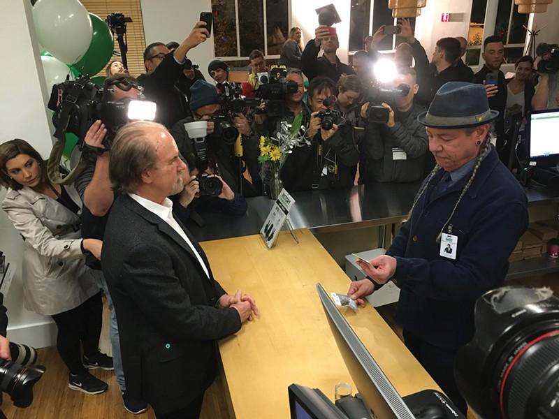 Harborside CEO Steve DeAngelo checks ID on Jan. 1, 2018. - PHOTO BY DAVID DOWNS