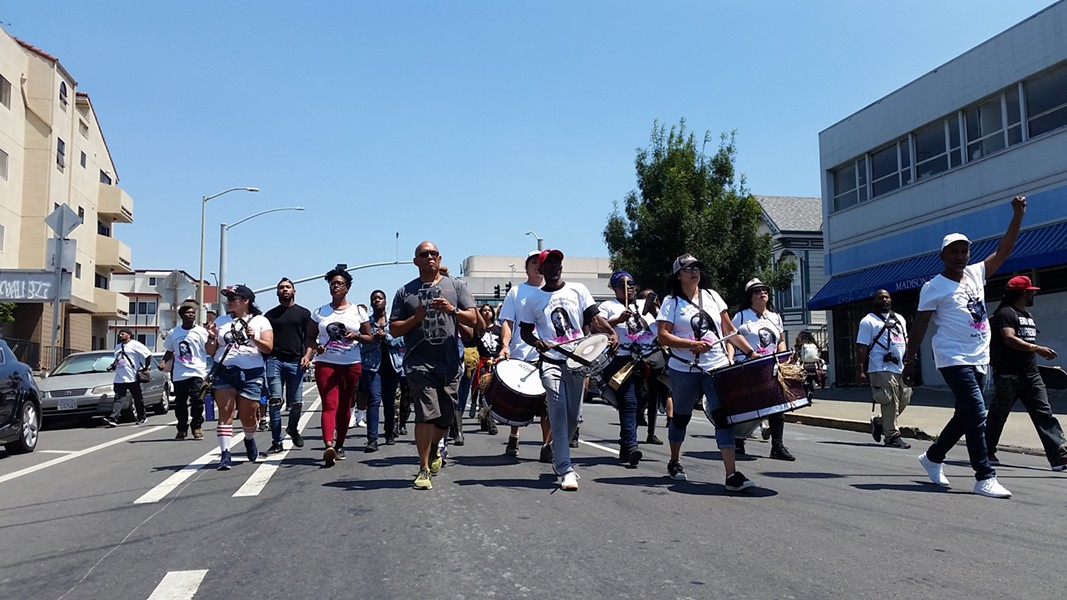 """Protesters marched through downtown Oakland chanting """"Justice for Nia"""" as they made their way to the offices of KTVU, demanding accountability for the local news station's use of what they called a """"dehumanizing"""" photo. - JOSH SLOWICZEK"""