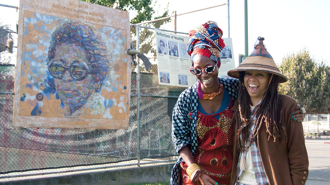 Karen Seneferu (left) and Melorra Green have grown their exhibit over the years. - PHOTO BY DREW COSTLEY