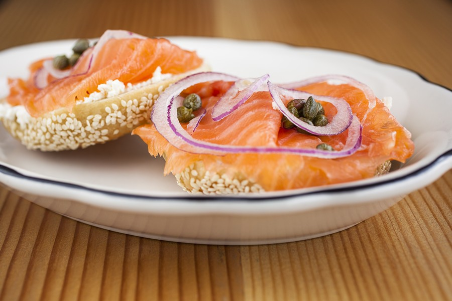 Beauty's Bagel Shop's open classic features plain cream cheese, smoked salmon, capers, and onions. - PHOTO BY CPLUSN