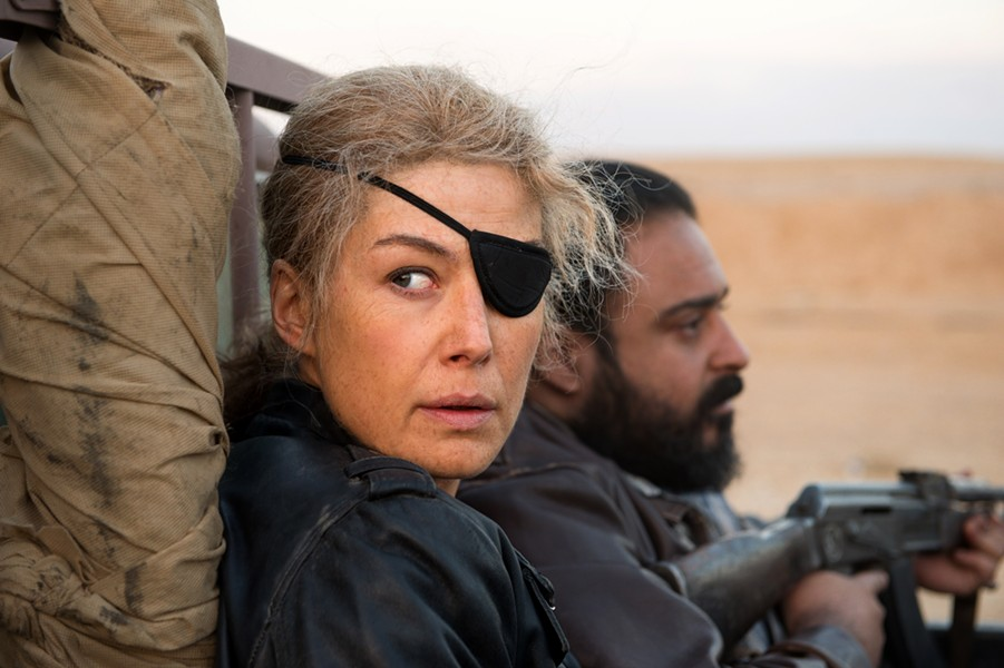Rosamund Pike surrounds herself with danger.