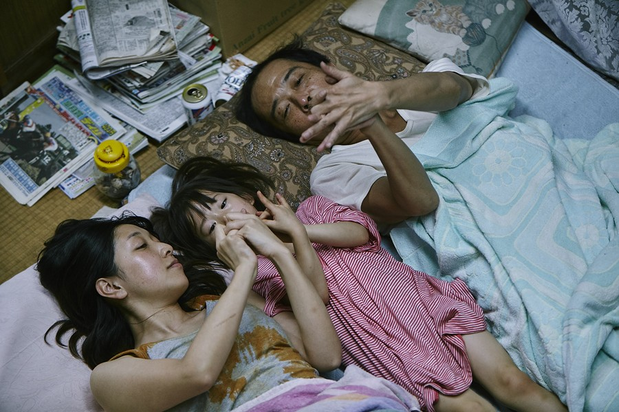 caption: Sakura Ando, Miyu Sasaki, and Lily Franky star in Shoplifters.