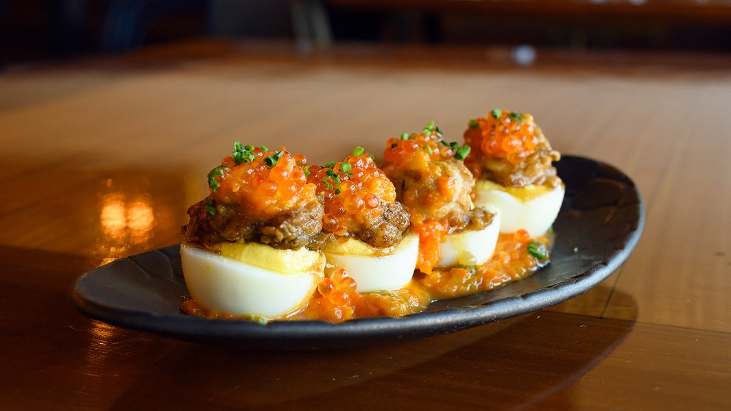 The fried oyster deviled eggs are decadently topped with trout roe. - PHOTO BY LANCE YAMAMOTO