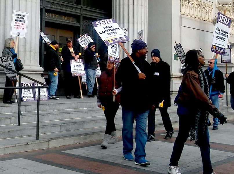Members of SEIU Local 1021 protesting in front of Oakland City Hall in 2018. - DARWIN BONDGRAHAM
