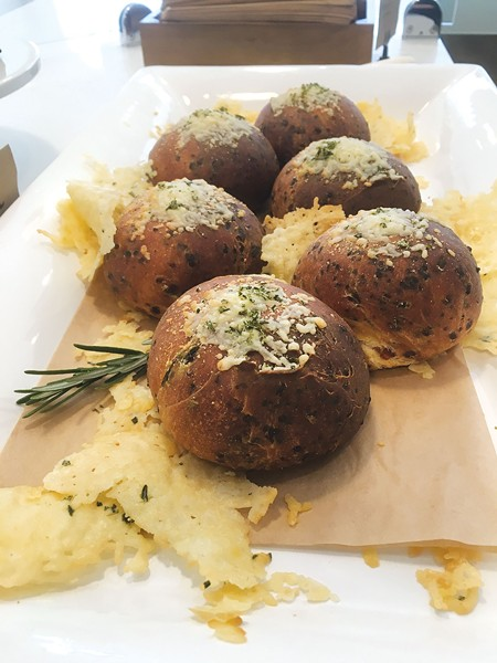 ROSE BREAD: Customers of Wild Rabbit Bakery on Grand Avenue in Oakland can pre-order the rosemary parmesan brioche and other baked goods.