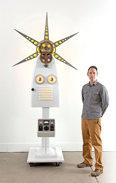 GHOST IN THE MACHINE:  Gould stands with his 'Deus Machina.'  - PHOTO COURTESTY OF NEMO GOULD