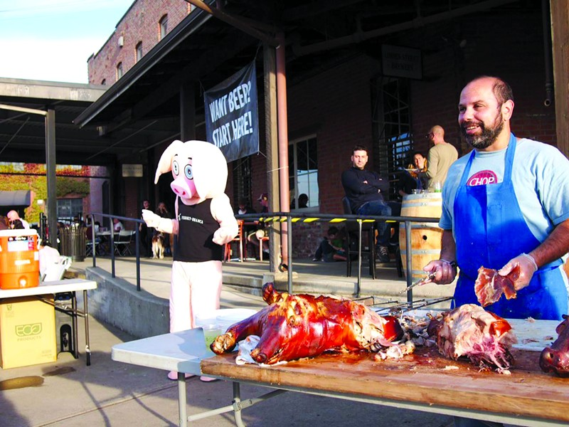 Chop Bar's Chris Pastena serves up some pig.