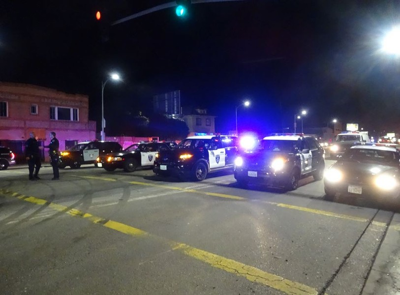 Oakland police blockade International Boulevard at 54th Avenue on Sunday night to disrupt a sideshow that involved 150 vehicles. - DARWIN BONDGRAHAM