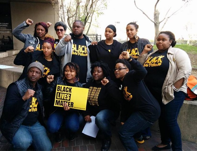 Members of the Black Friday 14 at a recent rally outside the office of District Attorney Nancy O'Malley.