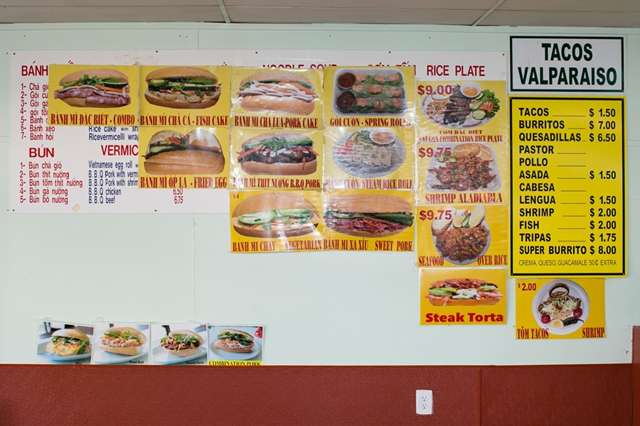 At Saigon Deli Sandwich & Taco Valparaiso, a banh mi menu occupies the left side of one of the restaurant's walls, while a fairly traditional taqueria menu occupies the right. - BERT JOHNSON