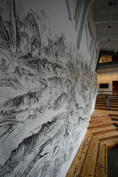 A site-specific mural by Qiu Zhijie above the amphitheater designed by Paul Discoe. - BERN JOHNSON