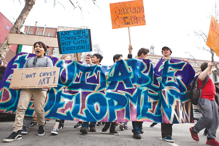 Students and other activists marched last week to protest the destruction of the Alice Street Mural. - BERT JOHNSON