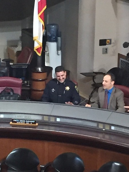 Soon-to-be former acting OPD police chief Paul Figueroa this past Tuesday at city council, before his appointment on Wednesday (and, apparently, with something to smile about). - PHOTO BY ALI WINSTON