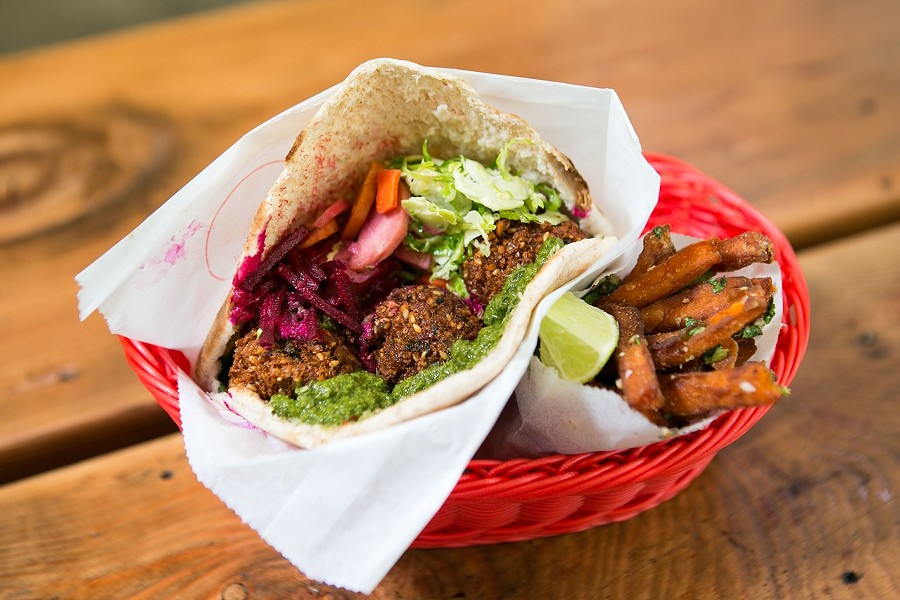 A falafel sandwich and sweet potato fries. - BERT JOHNSON/FILE PHOTO