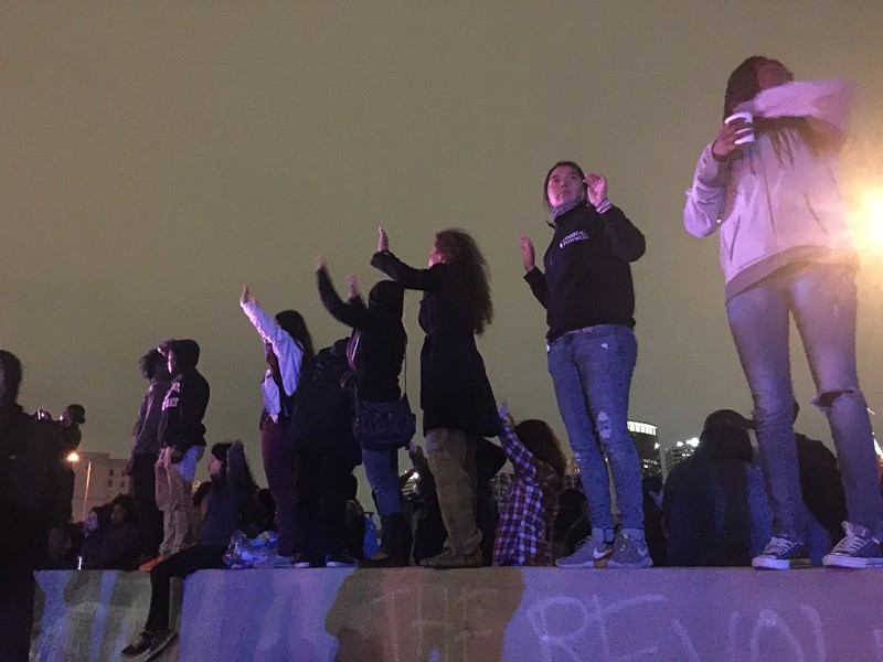 "Activists stood on the median and chanted ""Hands up, don't shoot."""