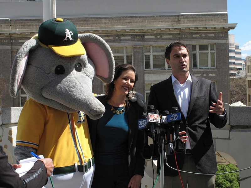 Mayor Libby Schaaf gets a hug from Stomper during a press conference with A's president David Kaval on Monday morning. - NICK MILLER