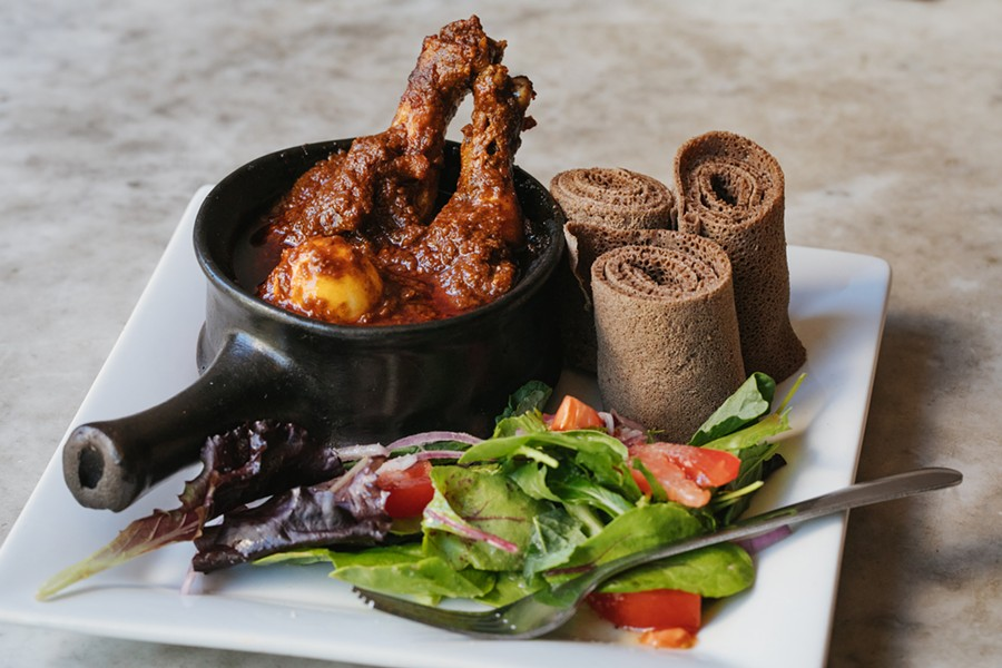 The doro wot's thick sauce clung to simple chicken drumsticks, which tasted as rich as beef. - ANDRIA LO