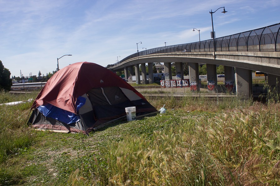 A tent on a plot of land east of downtown Oakland near 16th Avenue this past April. - PHOTO BY HAYDEN BRITTON