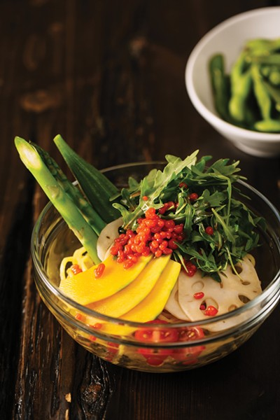 Unconventional ramen toppings, including squash and cherry tomatoes. - ANDRIA LO