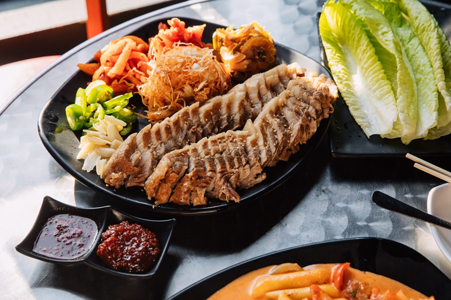With thin slices of pork belly and a bounty of vegetables, the bossam platter could function as dinner for two or three people. - ANDRIA LO