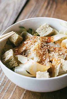 The cold-skin noodles are served with cucumbers, bean sprouts, and spongey gluten.