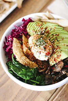 This vegetarian power bowl is finished with tempeh, avocado, and a poached egg.