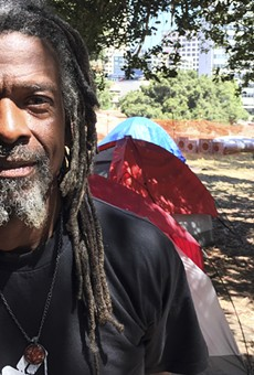 """Nino Parker organized """"green teams"""" to pick up trash around homeless camps."""