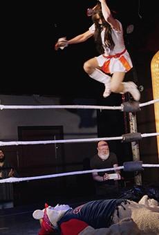 Nurse Ratchet dives onto Pooh Jack at Hoodslam's Sexy Good Time Wrestle Show.