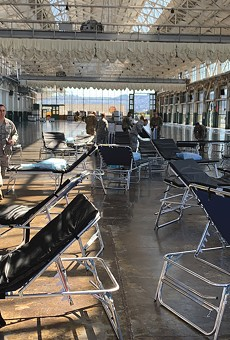 SUCCESS STORY: National Guard troops help outfit Craneway Pavilion as an emergency medical facility.