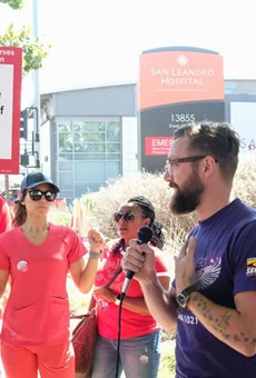 Nurses and other health care workers picketing at San Leandro Hospital, a health care facility operated by Alameda Health System.