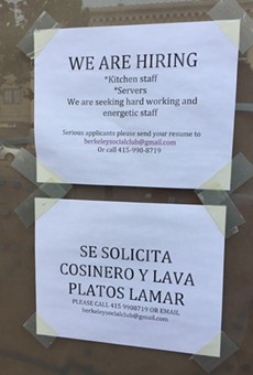 Hiring signs in the window of soon-to-be opened Berkeley Social Club at 2050 University Avenue.