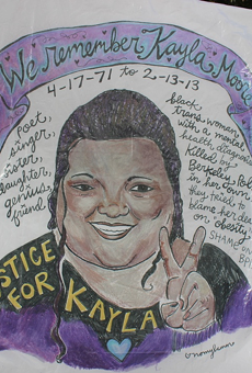A poster of Kayla Moore displayed outside the courthouse.