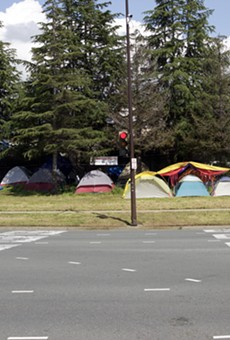 """Several tents dotted the """"Here-There"""" homeless encampment on the Berkeley border this past spring. City officials aim to build more transitional housing to move people off of the streets."""