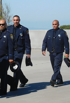Oakland police officers arriving at today's private ceremony.
