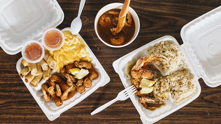 A spread of fried shrimp, lumpia, and mac 'n' cheese (left), plus gumbo, crab, and rice. - PHOTO BY MELATI CITRAWIREJA